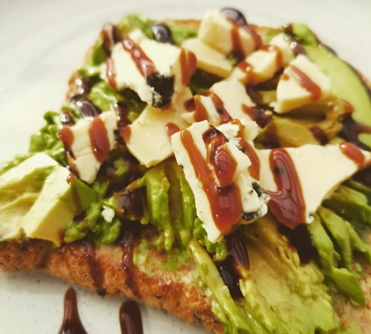 Smashed Avocado Topped with Blue Cheese and Balsamic Glaze